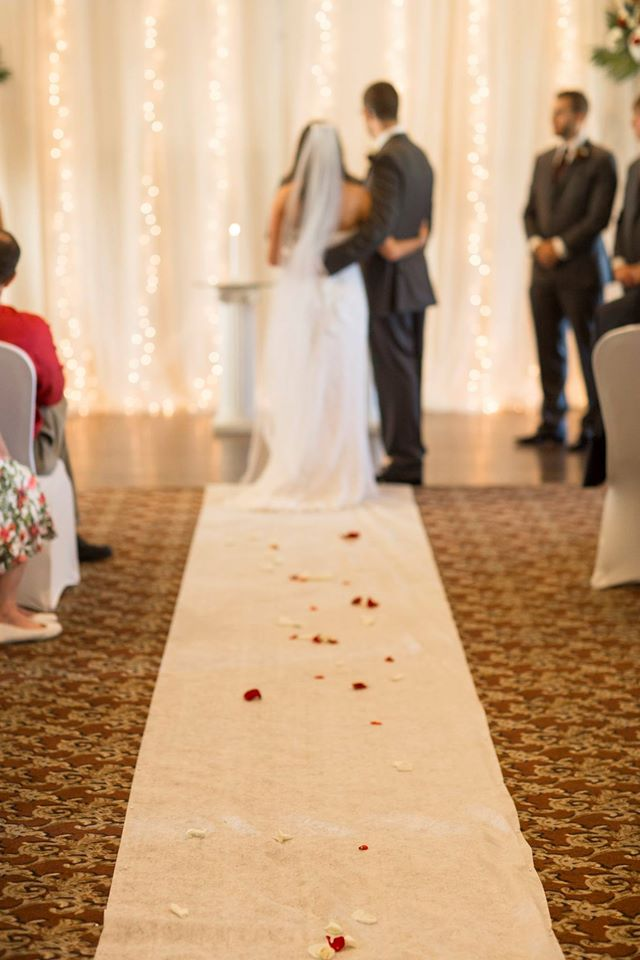 A couple stands at the altar on their wedding day at Dye's Walk Country Club